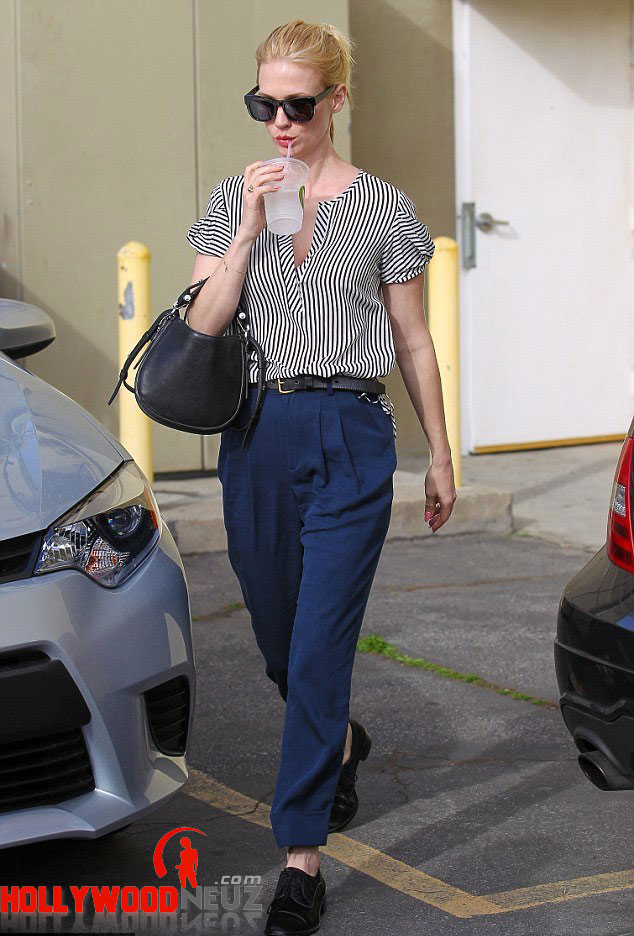 hollywood gossip, hollywood latest news, hollywood news, hollywood news today, January Jones, wears, high-waisted trousers, blue striped shirt